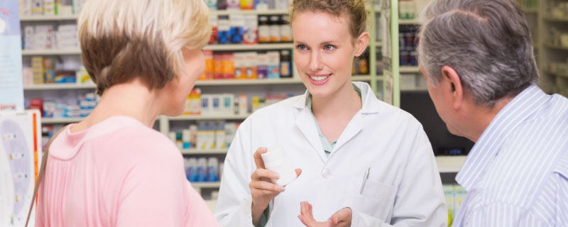 Customers talking to pharmacist